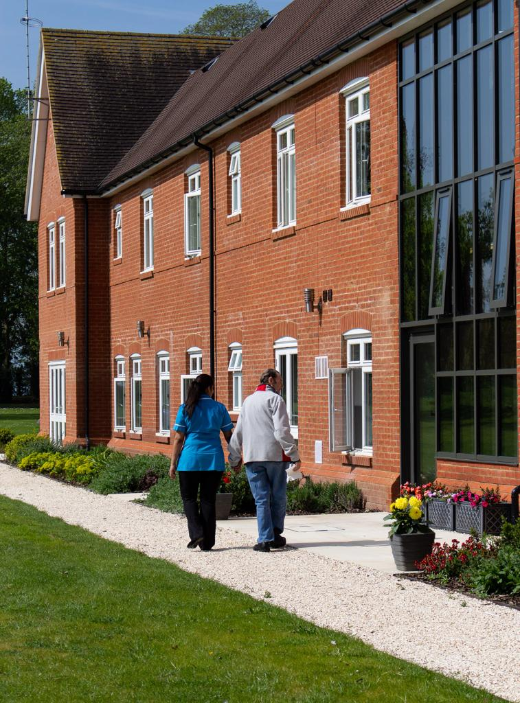 Taking a walk outdoors to enjoy spring sunshine at Peverel Court Care