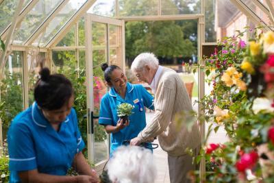 Residents enjoying the flowers at Bartlett's residential care home Aylesbury Bucks