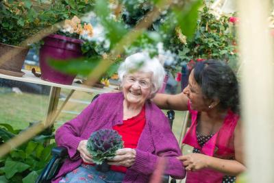 Residents enjoying the garden at Bartlett's residential care home Aylesbury Bucks